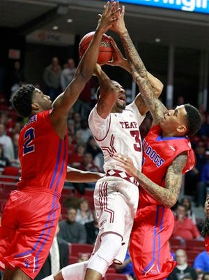 Temple's Jesse Morgan, center, gets fouled between Louisiana Tech's Erik McCree, left, and Michale Kyser, right, during the first half of an NCAA college basketball game in the National Invitation Tournament, Wednesday, March 25, 2015 at the Liacouras Center in Philadelphia. (AP Photo/The Philadelphia Inquirer, Charles Fox)  PHIX OUT; TV OUT; MAGS OUT; NEWARK OUT