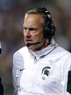 Why is Mark Dantonio so happy? Michigan State is moving up in the power rankings.