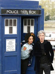 """British actor Peter Capaldi, in costume as Doctor Who, and Pearl Mackie as his new companion Bill Potts, pose with a replica of the TARDIS, to promote the new Doctor Who TV series on the Southbank in London, Wednesday April 12, 2017. After three seasons of zooming through space and time, Peter Capaldi is preparing to hang up his sonic screwdriver and depart """"Doctor Who."""""""