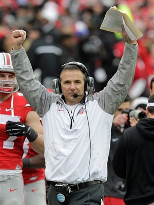 Ohio State head coach Urban Meyer reacts to Ohio State scoring a touchdown against Michigan during the fourth quarter of an NCAA college football game Saturday, Nov. 29, 2014, in Columbus, Ohio. Ohio State beat Michigan 42-28. (AP Photo/Jay LaPrete)