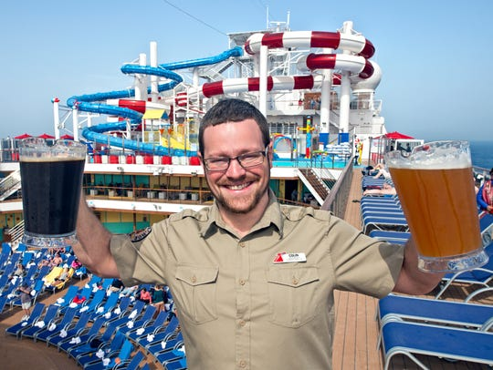 Carnival Horizon brewmaster Colin Presby displays pitchers