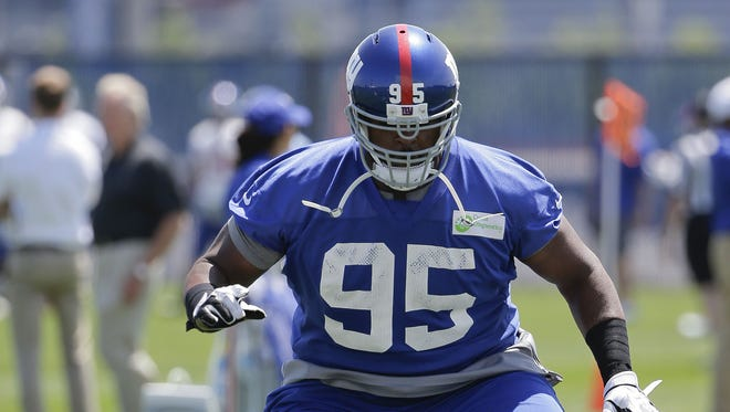 New York Giants defensive tackle Johnathan Hankins runs through drill  during NFL football minicamp, Wednesday, June 18, 2014, in East Rutherford, N.J.