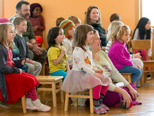 Students, their parents and staff of the Ithaca Waldorf School watch members of the Cornell Vietnamese Association perform Friday afternoon at a celebration of the Lunar New Year at the school in Danby.