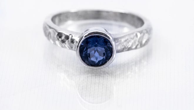 A custom-designed, one-carat Iolite sterling silver Signature Grace ring is one of the items to be auctioned off.