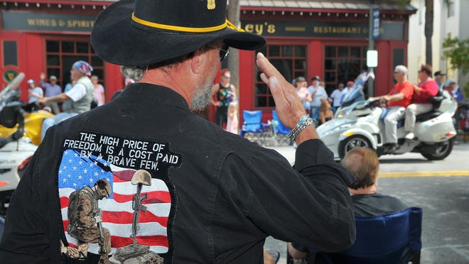 Bill Keane, an Army veteran, salutes fellow veterans during the 2016 Fourth of July parade in downtown Melbourne. The city did not hold a parade this year.