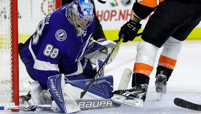 Andrei Vasilevskiy, left, had 32 saves in the first time the Flyers were shut out this season.