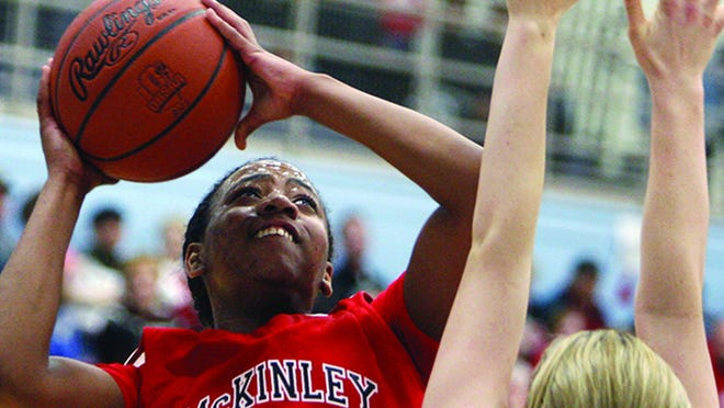 McKinley's Ameryst Alston puts up a shot during a tournament game at Alliance High School.