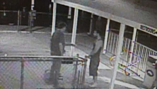 Ottawa County Sheriff's Office Detective Amanda Cross is seeking information of the man standing on the right in this photo. Assault victim Karl Goss is at left. Anyone with information is asked to call 419-734-4404.