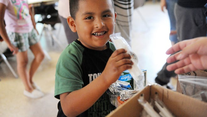 In this file photo, Gael Acosta gets a healthy lunch at the Hebbron Family Center.