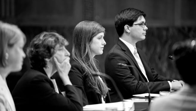 Dana Bolger, with long hair, testifies on Capitol Hill about campus sexual assault.