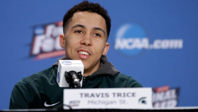 Michigan State's Travis Trice answers a question during a news conference for the NCAA Final Four tournament college basketball semifinal game Thursday, April 2, 2015, in Indianapolis.