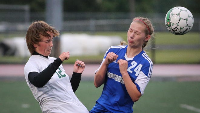 Samantha Captain of Oshkosh North, left, and Amber Nolle of Green Bay Southwest collide while heading the ball in a WIAA Division 2 girls soccer sectional semifinal at J.J.Keller Field at Titan Stadium Thursday evening, June 11, 2015.
