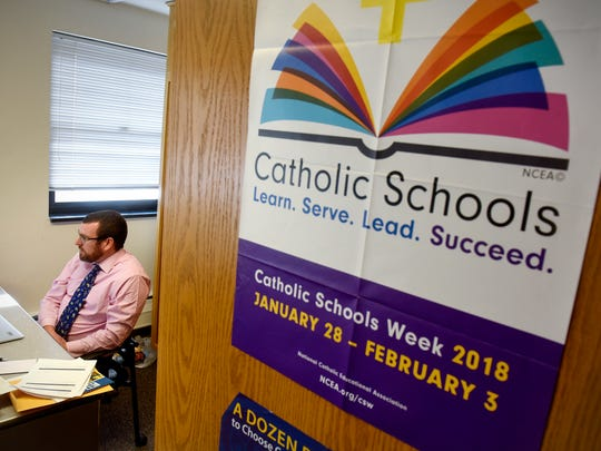 Kevin Powers, superintendent for Catholic Community Schools, talks while in his office at the Diocese of St. Cloud Pastoral Center in St. Cloud on Friday, Jan. 19.