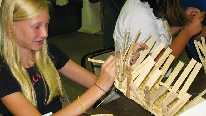 Kathryn Lienhard learned to hand weave a sturdy basket in a past Renfrew Institute summer workshop. Basketry is among the six summer camps - three crafts and three outdoor activities - for kids offered by the institute in a new partnership with the Waynesboro YMCA's Summer Day Camp.