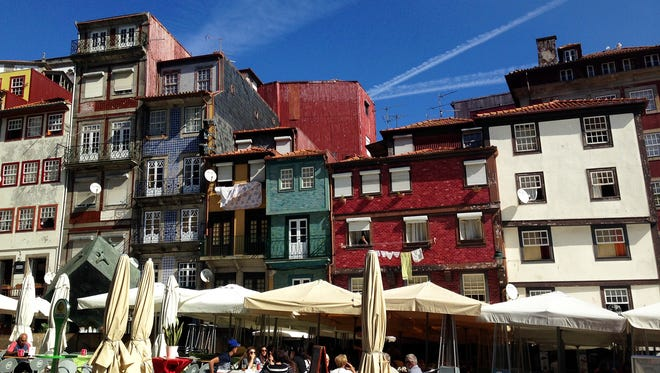"""The colorful Ribeira district of Porto, Portugal's """"second city,"""" has been transformed from rust-belt drab to bohemian chic."""