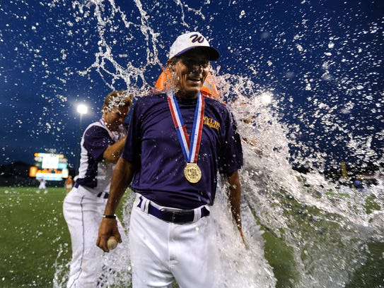 Wylie head coach Clay Martin  gets doused with water