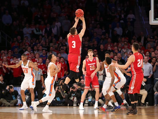 Wisconsin Badgers guard Zak Showalter (3) hits a shot to tie the game with 2.1 seconds left against the Florida Gators in the semifinals of the East Regional of the 2017 NCAA Tournament at Madison Square Garden.