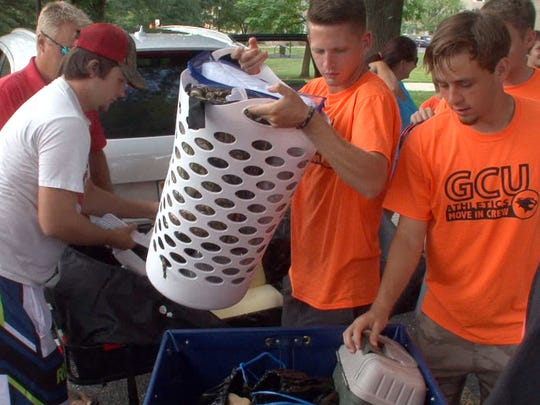 Georgian Court University student athletes help to transfer a freshman's dorm room contents into St. Joseph's Hall at the Lakewood campus Thursday,  August 20, 2015.