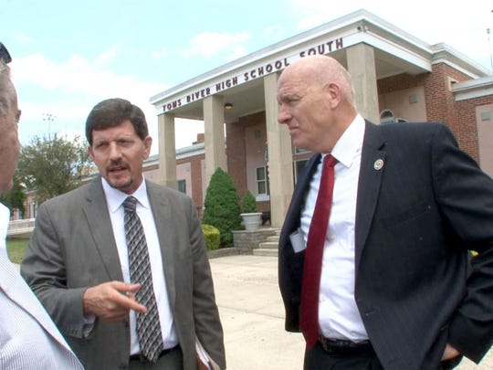 Toms River Board of Education member Russell K. Corby (left), district Business Administrator William J. Doering (center) and Superintendent of Schools David M. Healy (right) discuss last minute cuts in state aid on June 21, 2017.
