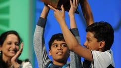 Nihar Janga, 11, of Austin, Texas (L), and Jairam Hathwar,