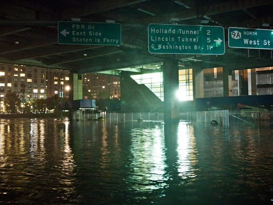 A flooded street, caused by Hurricane Sandy, is seen