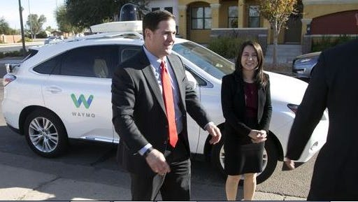 Arizona Gov. Doug Ducey is introduced to Google's Waymo self-driving car with help from Waymo Director of Operations Jennifer Haroon