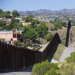 The border fence separates Nogales, Sonora (left) with Nogales, Ariz. April 21, 2014.