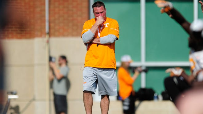 Tennessee coach Butch Jones watches warmups during spring practice on Tuesday  at Anderson Training Facility.