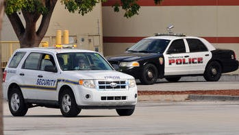 Extra security noticeable in the parking lot of the Melbourne Square mall Sunday morning after Saturday's shootings.