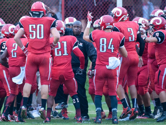 DuPont Manual Crimsons head varsity football coach Oliver Lucas revs up his team before game start as duPont Manual takes on PRP at Manual.?12 Sept 2014