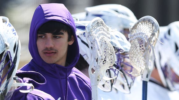 John Jay's Braden Burke watches from the sidelines