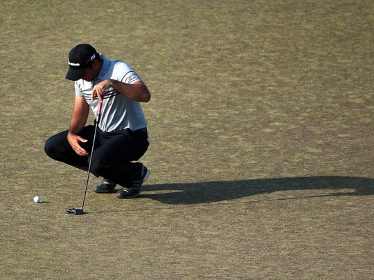 Jason Day waits on the 18th green during the third round.