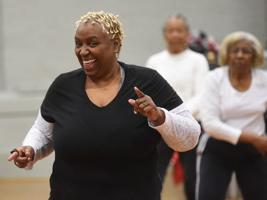 Christine Lincoln of York city line dances during the first Healthy Movin' Mondays at Voni Grimes Gym in February.