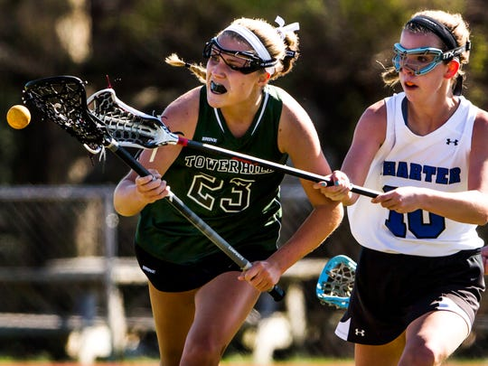 Tower Hill's Abby Manning, the Delaware girls lacrosse Co-Player of the Year, battles for possession with Charter of Wilmington's Elyse Lamey.