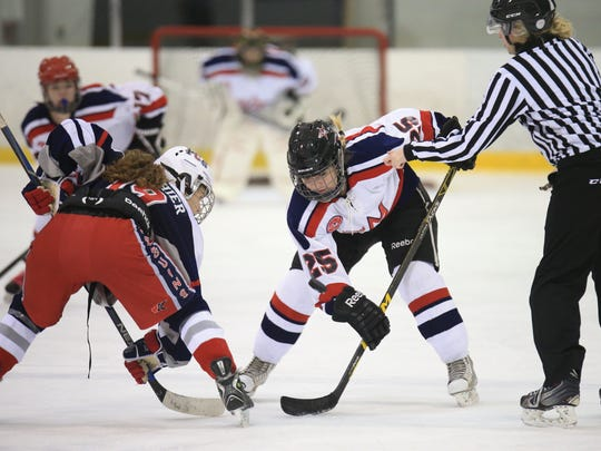 Brooke Gauthier (19) of the Penguins and Mackenzie Compton of Livonia United get set for a face-off.