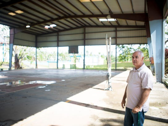 Candido Rivera, the school director at Escuela Superior, stands in the gym, which the school hasn't been able to use since Hurricane Maria.