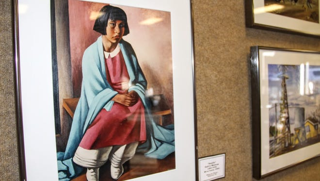 A photograph of a painting painted during the Great Depression is displayed at Patron's Hall as part of the Tularosa Basin Museum of History's New Deal Federal Arts Project art exhibit.