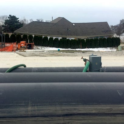 The temporary sewer bypass piping on top of 15 Mile