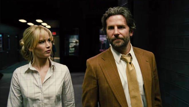 Joy (Jennifer Lawrence) and Neil (Bradley Cooper) tour QVC studios, in a scene from David O. Russell's 'Joy.'