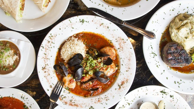 Seafood Creole, middle, and other menu items at Gallo's Kitchen and Bar.