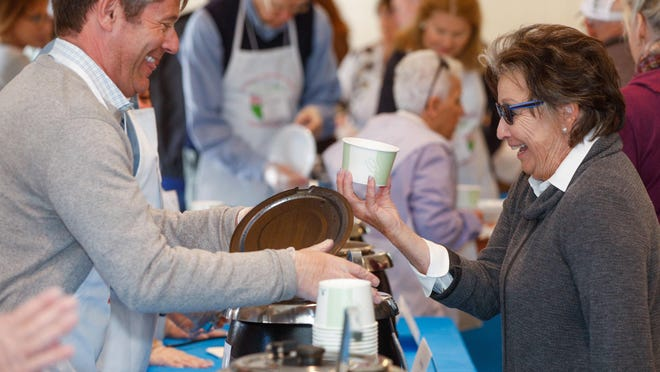 Matthew Constantine ladles out a bowl of cream of mushroom soup from the Sailfish Club to Jen Dudnyk of Palm Beach Gardens during the 2020 Empty Bowls event Friday The Episcopal Church of Bethesda-by-the-Sea.