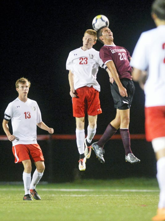 Susquehannock's Luke Thomas, center left, and Gettysburg's Connor Weikert, right, compete to head the ball during the second half of Thursday's match. Gettysburg won, 3-0.