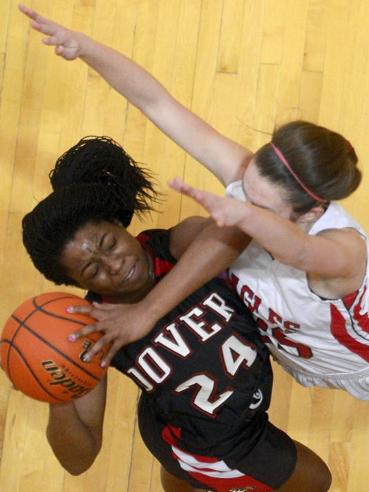 Dover's Alayah Hall drives to the hoop against Cumberland Valley's Kelly Jekot during the PIAA Class AAAA quarterfinal girls' basketball game against Cumberland Valley at Milton Hershey High School in Hershey Friday, March 14, 2014. Dover lost 45-36. Kate Penn -- Daily Record/Sunday News