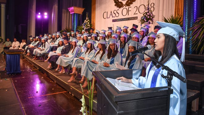 """Valedictorian Erin Camemo delivers her farewell address during Notre Dame High School's 49th commencement exercise at Father Duenas Memorial School's Phoenix Center in Mangilao on Saturday, May 19, 2019. """"We have come so far, in the past four years, and today marks one of our greatest accomplishments in our lives,"""" said Camemo to her fellow graduates. """"It is the beginning of a new and exciting journey for all of us,"""" she added. Camemo and 58 other Royals were handed their high school diplomas at the ceremony."""