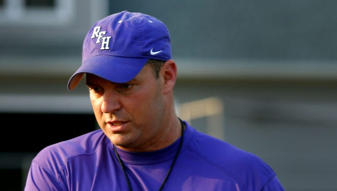 Then-Rumson-Fair-Haven football head coach Bryan Batchler talks to players during practice in August.