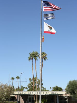 A thin blue line flag recognizing fallen police officers flies at the Palm Springs City Hall, September 27, 2017.