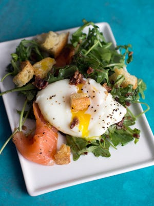 Lyonnais-style salad with smoked salmon and poached egg, which not only makes the salad substantial, but thanks to the luxurious way the yolk coats the greens once it's been broken, it also acts as an extra sauce.