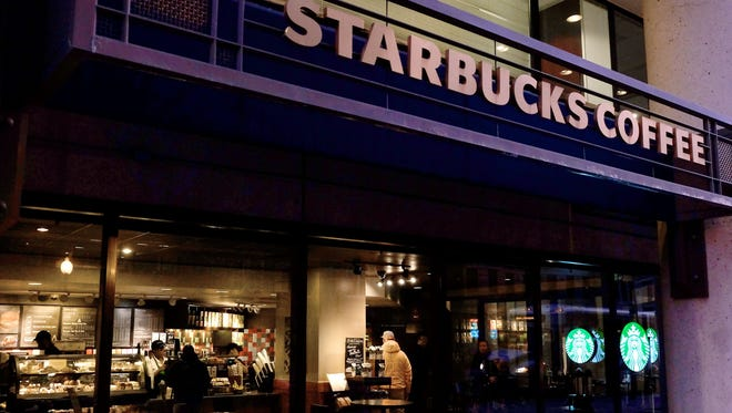"Starbucks store is seen March 18, 2015, in Washington, D.C. Starbucks customers can now add discussion about racism to their latte order. In an initiative that has raised some eyebrows, the head of the U.S. coffee shop chain has called on baristas in the U.S. to discuss the sensitive issue with customers. Starbucks CEO Howard Schultz launched the ""Race Together"" program, saying the U.S.  needs a ""new level of sensitivity, understanding around these issues."""