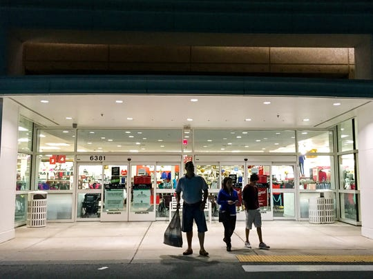 Black Friday shoppers trickle in and out of the Kohl's on Naples Boulevard before dawn on Friday, Nov 27, 2015, in North Naples.