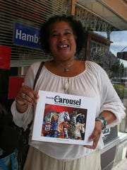 Marie Bradford-Blevins, executive director of Salem's Riverfront Carousel, is promoting a benefit for the carousel, and its gift shop, which sells items such as the book she is holding.